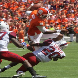 Quarterback Deshaun Watson #4 of the Clemson Tigers hurtles over free safety Mariel Cooper #20 of the South Carolina State Bulldogs on September 6, 2014 at Memorial Stadium in Clemson, South Carolina. (Photo by Mary Ann Chastain/Getty Images)