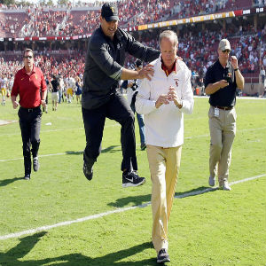 USC head coach Steve Sarkisian jumps in celebration with Athletic Director Pat Haden after they beat the Stanford Cardinal at Stanford Stadium on September 6, 2014 in Palo Alto, California. EZRA SHAW/GETTY IMAGES