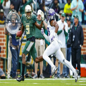 Oct 11, 2014; Waco, TX, USA; Baylor Bears wide receiver KD Cannon (9) catches a touchdown pass as TCU Horned Frogs cornerback Nick Orr (18) chases during the first half at McLane Stadium.