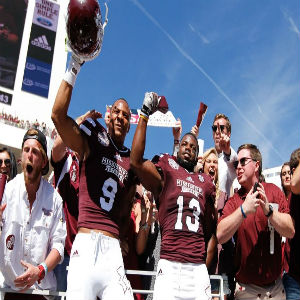Oct 4, 2014; Starkville, MS, USA; Mississippi State Bulldogs defensive back Justin Cox (9) and Mississippi State Bulldogs running back Josh Robinson (13) celebrate their teams win against the Texas A&M Aggies at Davis Wade Stadium. The Bulldogs defeated the Aggies 48-31. Mandatory Credit: Marvin Gentry-USA TODAY Sports