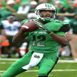 "Marshall's quarterback Rakeem Cato (12) looks for a receiver in the ""Battle for the Bell"" against the Ohio Bobcats at Joan C. Edwards Stadium. Charleston Daily Mail/Craig Cunningham 9/13/14"